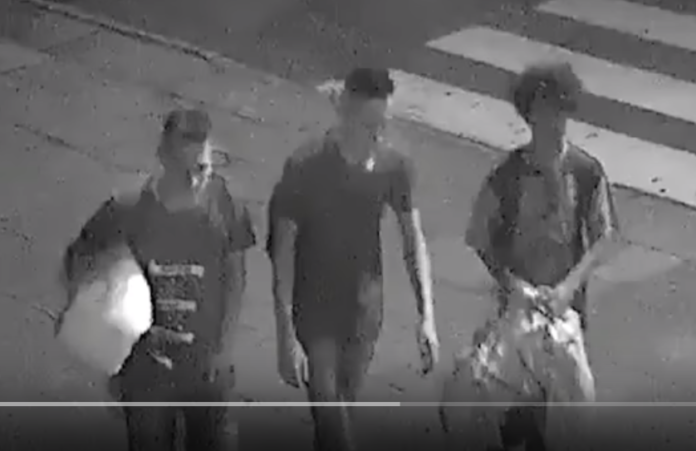 Three Young Men Helping Homeless Man