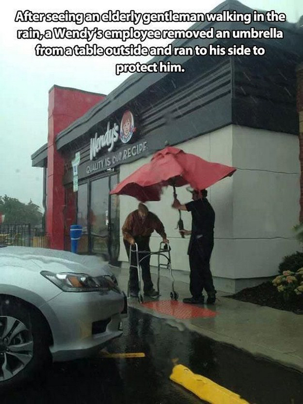 Holds an Umbrella for an Elderly Gentleman!